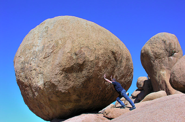 Pushing Giant Boulder