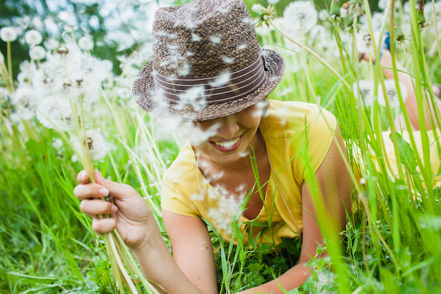 Happy Woman with Dandelions
