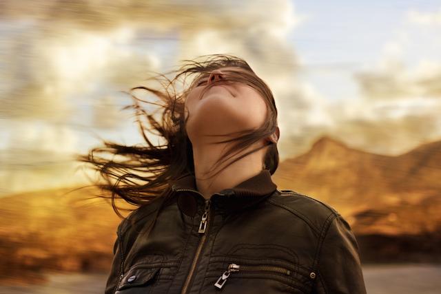 Woman Breathing Deeply