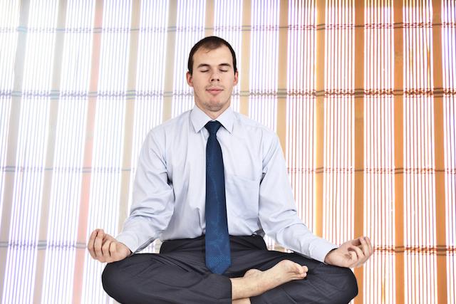 Man Meditating at Work