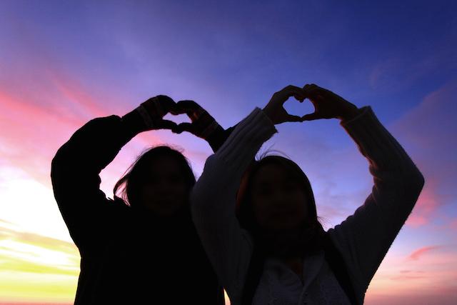 Friends Making Heart Symbol