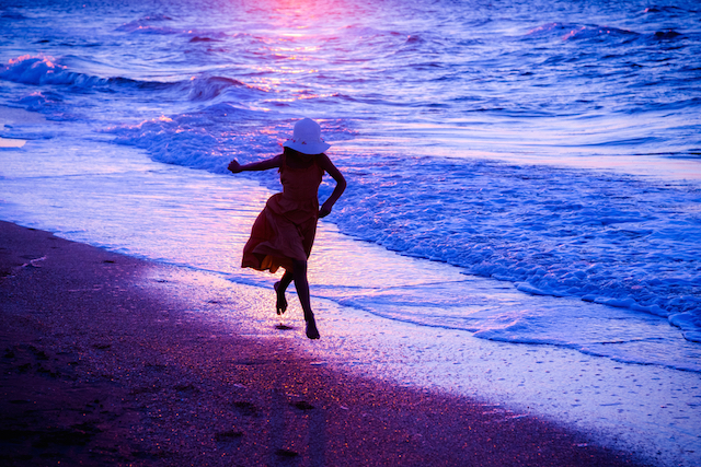 Girl Skipping at the Surf
