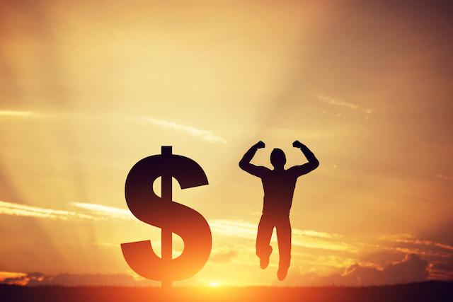 Man Jumping Next to Dollar Symbol