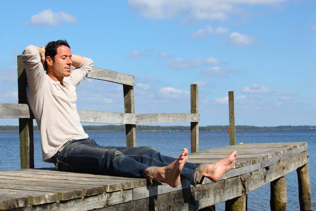 Man sitting on pier