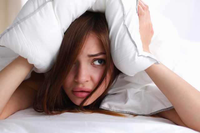 Woman Hiding Under Pillow