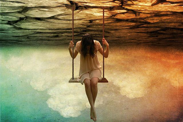 Sad woman on swing